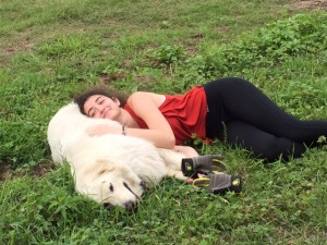A Waldorf student taking a lunch break with her favorite farm animal